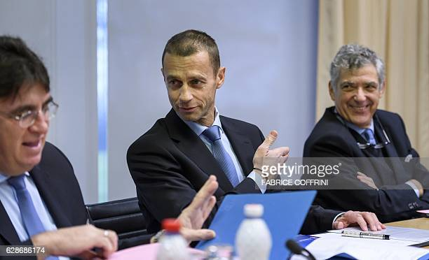 President Aleksander Ceferin gestures between UEFA general secretary Theodore Theodoridis and first vicepresident Angel Maria Villar Llona during the...