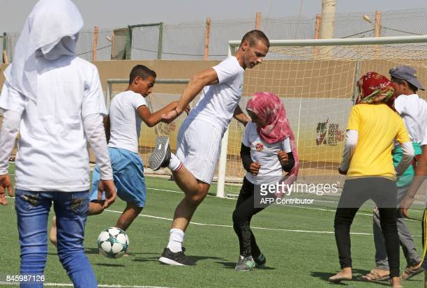 President Aleksander Ceferin plays football during the opening ceremony of a football field at the Zaatari refugee camp 80 kilometers north of the...