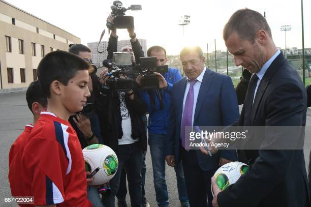 President Aleksander Ceferin signs a soccer ball for a kid after the groundbreaking ceremony of the Football Academy with the attendance of Football...