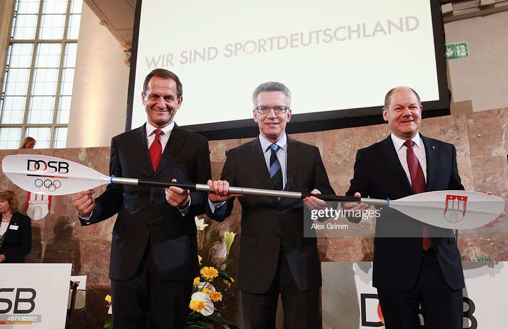 President Alfons Hoermann, German Interior Minister Thomas de Maiziere and Hamburg mayor Olaf Scholz (L-R) pose after Hamburg was announced German candidate city for the 2024/2028 Olympic games during the DOSB extraordinary assembly at Paulskirche on March 21, 2015 in Frankfurt am Main, Germany.