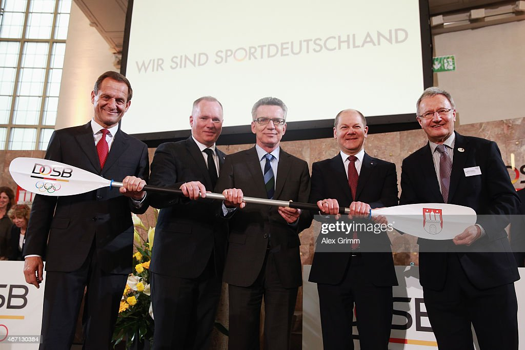 President Alfons Hoermann, Hamburg Senator for sports Michael Neumann, German Interior Minister Thomas de Maiziere, Hamburg mayor Olaf Scholz and Friedhelm Julius Beucher, head of German Paralympic Sport Association (L-R) pose after Hamburg was announced German candidate city for the 2024/2028 Olympic games during the DOSB extraordinary assembly at Paulskirche on March 21, 2015 in Frankfurt am Main, Germany.