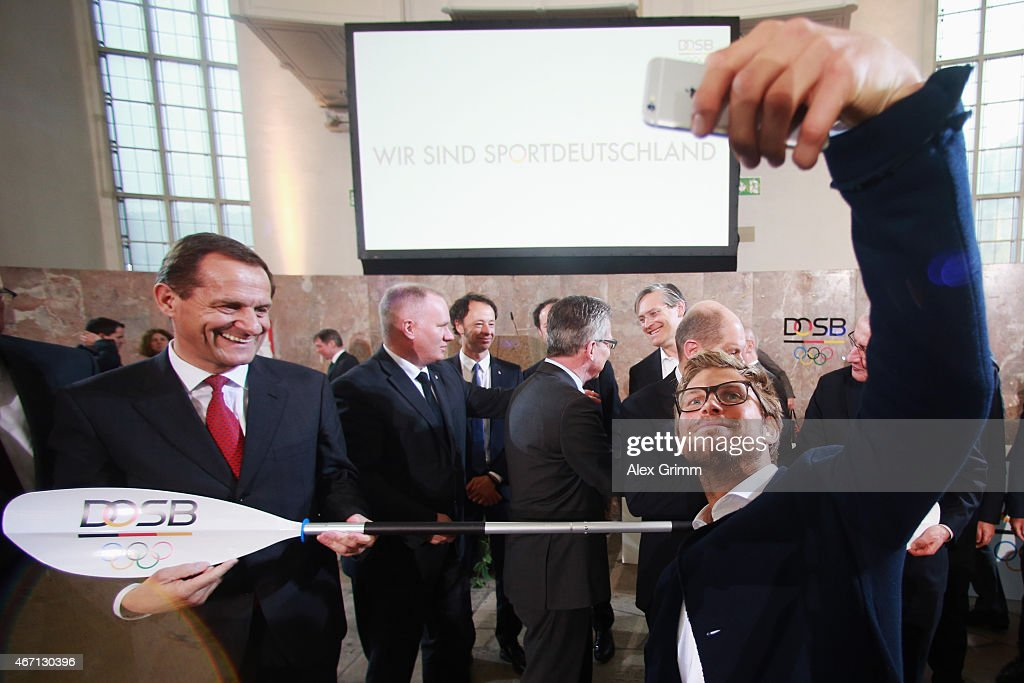 President Alfons Hoermann watches Moritz Fuerste shoot a selfie after Hamburg was announced German candidate city for the 2024/2028 Olympic games during the DOSB extraordinary assembly at Paulskirche on March 21, 2015 in Frankfurt am Main, Germany.