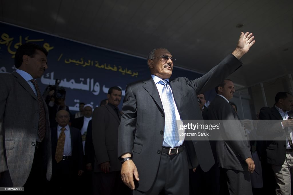 President <a gi-track='captionPersonalityLinkClicked' href=/galleries/search?phrase=Ali+Abdullah+Saleh&family=editorial&specificpeople=221711 ng-click='$event.stopPropagation()'>Ali Abdullah Saleh</a> waves to his supporters before a giving a speech March 10, 2011 in Sana, Yemen. Thousands of Yemenis have been protesting around the country calling for the ouster of President <a gi-track='captionPersonalityLinkClicked' href=/galleries/search?phrase=Ali+Abdullah+Saleh&family=editorial&specificpeople=221711 ng-click='$event.stopPropagation()'>Ali Abdullah Saleh</a>, who has been in power for 32 years.
