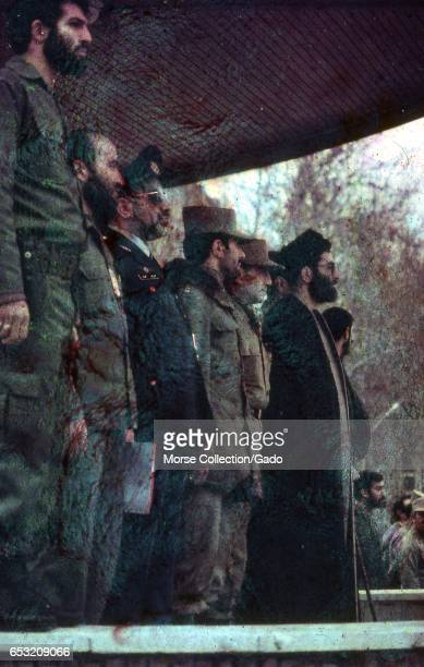 President Ali Khamenei standing center stage among a row of military leaders and Islamic clerics at a rally in Iran March 1983 Extensive damage on...