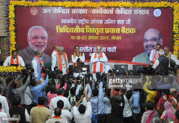 President Amit Shah along with Madhya Pradesh Chief Minister Shivraj Singh Chouhan during core group meeting at state BJP office on August 18 2017 in...
