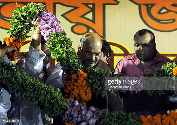 President Amit Shah and BJP MP Paresh Rawal during a public meeting for upcoming Phase V West Bengal Assembly election on April 26 2016 in Kolkata...
