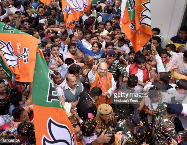 President Amit Shah arrives to address a press conference after landslide victory in Uttar Pradesh and Uttarakhand assembly elections at BJP HQ at...
