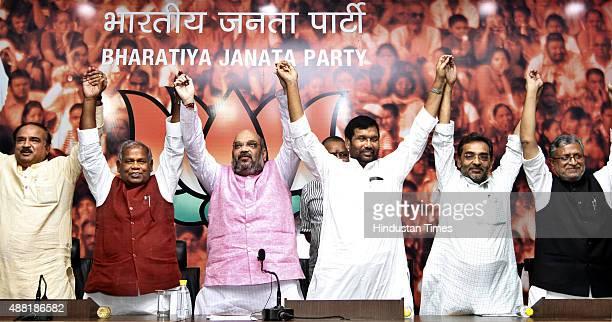 President Amit Shah HAM Chief Jitan Ram Manjhi LJP President Ram Vilas Paswan RLSP leader Upendra Kushwaha with BJP leaders Anant Kumar and Shushil...