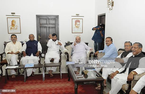 President Amit Shah LJP Chief Ram Vilas Paswan HAM Supremo Jitan Ram Manjhi RLSP President Upendra Kushwaha and other NDA leaders at a meeting to...