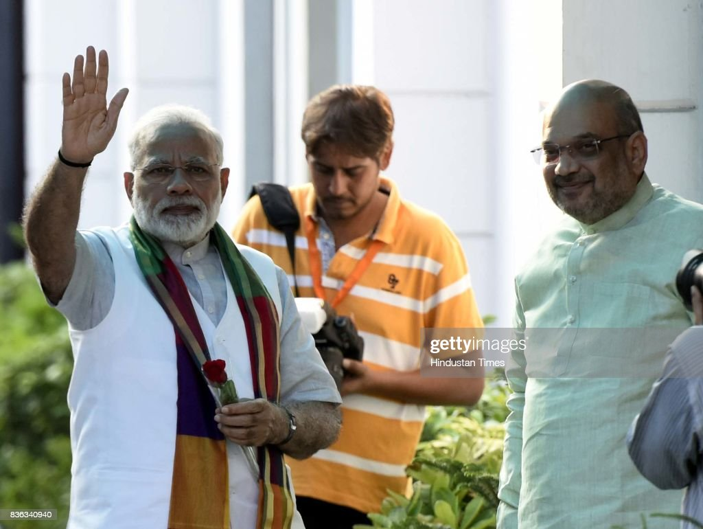 BJP President Amit Shah welcomes Prime Minister Narendra Modi at the party's Mukhyamatri Parishad Baithak (meeting of chief ministers of BJP-ruled states) on August 21, 2017 in New Delhi, India.
