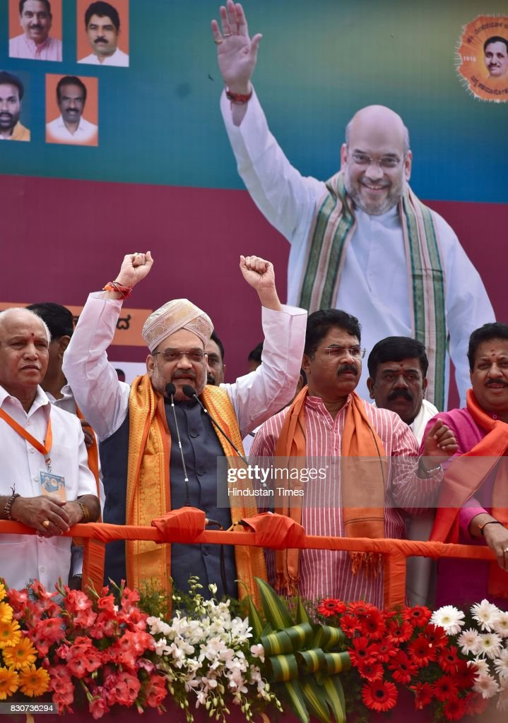 BJP President Amit Shah with Karnataka BJP state President BS Yeddyurappa during a public rally near Devanahalli, on August 12, 2017 in Bengaluru, India. Shah is on a three-day visit to Karnataka starting Saturday as part of his 110-day nationwide tour to strengthen the party. Shah said that he had come here to realise the resolution of forming the next BJP government in Karnataka.