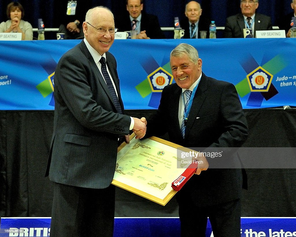BJA President and 10th dan, George Kerr CBE, right, presented BJA Technical Director and former Olympic team manager, Colin McIver with the honour of a 9th dan and a red belt during day 2 of the London British Open Judo Championships at the K2 on May 12, 2013 in Crawley, United Kingdom.