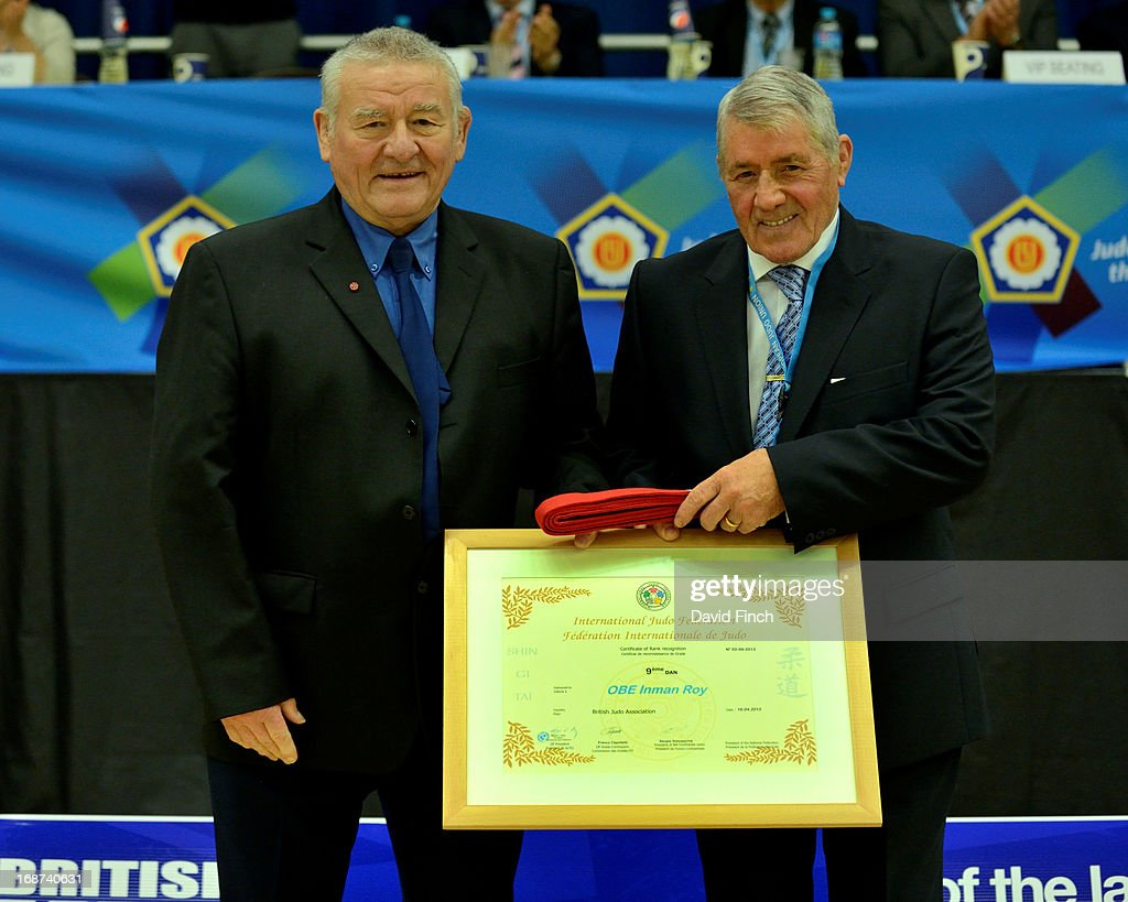 BJA President and 10th dan, George Kerr CBE, right, presented former highly successful British coach, Roy Inman OBE with the honour of a 9th dan and a red belt during day 2 of the London British Open Judo Championships at the K2 on May 12, 2013 in Crawley, United Kingdom.
