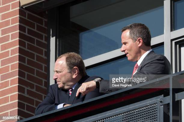 President and CEO Christopher Ilitch of the Detroit Red Wings watches the opening festivities with Commission Gary Bettman of the NHL prior to the...