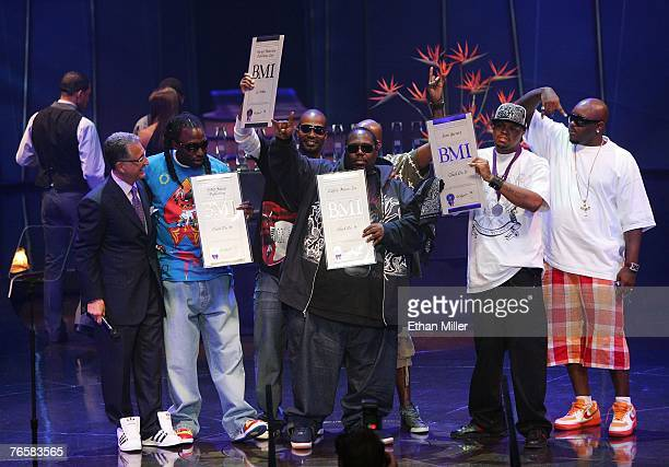 BMI President and CEO Del Bryant poses for photos with BMI award winners MJG Juicy J 8Ball and DJ Paul of the group Three Six Mafia during the 7th...
