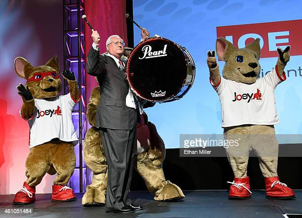 President and CEO Joe Clayton makes his entrance playing a drum with kangaroo characters at a press event for DISH at the Mandalay Bay Convention...