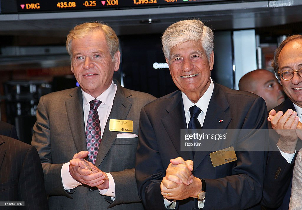President and CEO John Wren (L) and Publicis Groupe SA (Euronext Paris: FR0000130577) Chairman and CEO Maurice Lévy visit the New York Stock Exchange on July 29, 2013 in New York City.