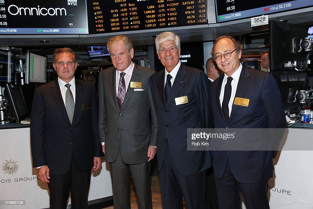 President and CEO John Wren and Publicis Groupe SA (Euronext Paris: FR0000130577) Chairman and CEO Maurice Lévy (C), accompanied by members of their leadership teams visit the New York Stock Exchange on July 29, 2013 in New York City.