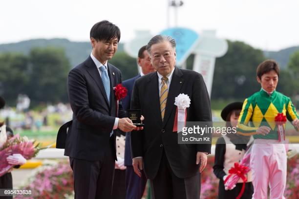 President and CEO Masayuki Goto presents the Yasuda Kinen winning souvenir to Satono Aladdin's trainer Yasutoshi Ikee at Tokyo Racecourse on June 4...