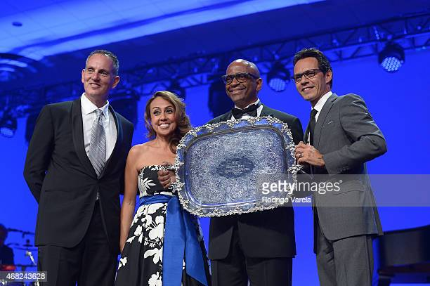 BMI President and CEO Mike O'Neill BMI Vice President Delia Orjuela Sergio George and Marc Anthony onstage at BMI's 22nd Annual Latin Music Awards at...