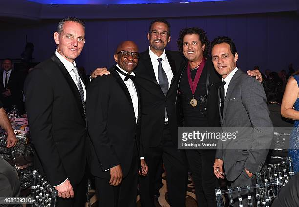 BMI President and CEO Mike O'Neill Sergio George Kike Santander Carlos Vives and Marc Anthony attend BMI's 22nd Annual Latin Music Awards at...