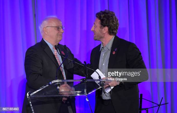President and CEO Newman's Own Foundation Robert H Forrester and Event cochair Marine veteran Founder of Headstrong Zach Iscol speak at the...