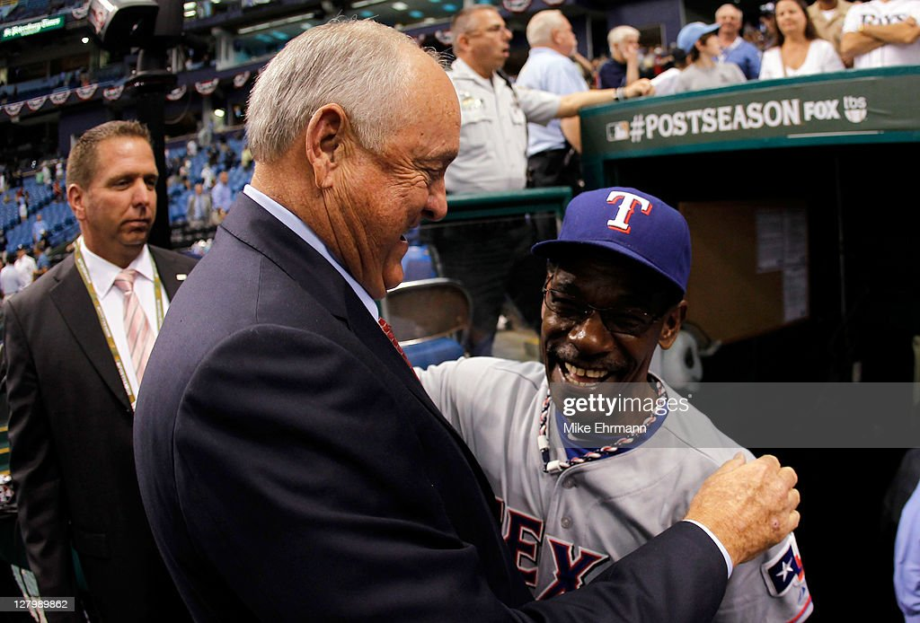 President and CEO <a gi-track='captionPersonalityLinkClicked' href=/galleries/search?phrase=Nolan+Ryan&family=editorial&specificpeople=202212 ng-click='$event.stopPropagation()'>Nolan Ryan</a> and manager <a gi-track='captionPersonalityLinkClicked' href=/galleries/search?phrase=Ron+Washington&family=editorial&specificpeople=225012 ng-click='$event.stopPropagation()'>Ron Washington</a> of the Texas Rangers celebrate after the Rangers defeat the Tampa Bay Rays 4-3 in Game Four of the American League Division Series at Tropicana Field on October 4, 2011 in St Petersburg, Florida. The Rangers victory sends them to the American League Championship Series.