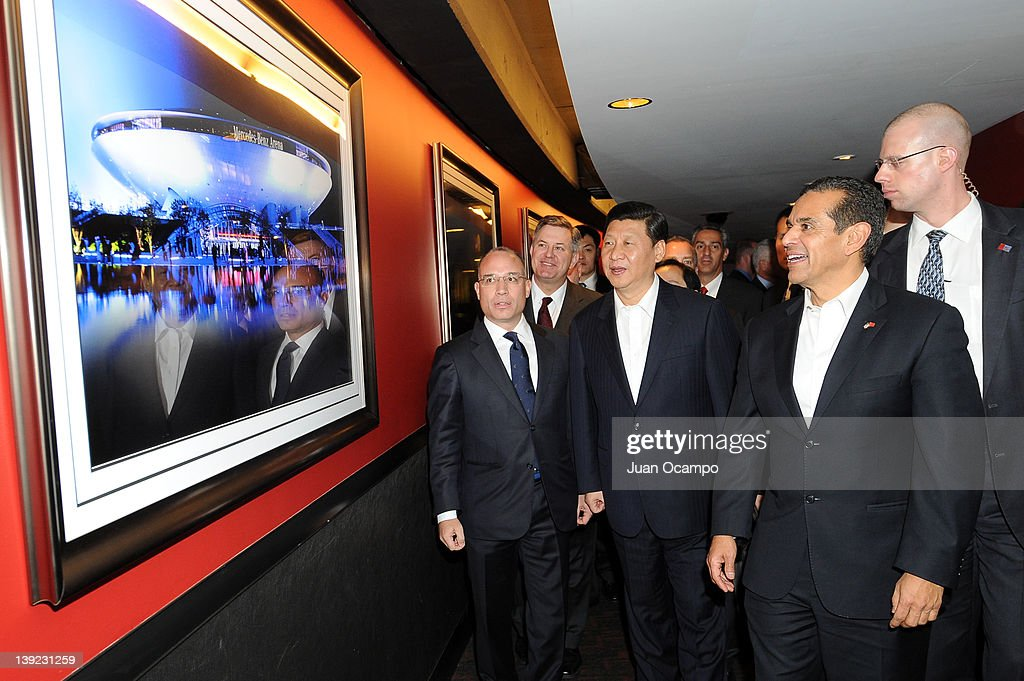 President and CEO of AEG China John Cappo, AEG President & CEO <a gi-track='captionPersonalityLinkClicked' href=/galleries/search?phrase=Tim+Leiweke&family=editorial&specificpeople=676996 ng-click='$event.stopPropagation()'>Tim Leiweke</a>, Chinese Vice President <a gi-track='captionPersonalityLinkClicked' href=/galleries/search?phrase=Xi+Jinping&family=editorial&specificpeople=2598986 ng-click='$event.stopPropagation()'>Xi Jinping</a>, and Los Angeles Mayor <a gi-track='captionPersonalityLinkClicked' href=/galleries/search?phrase=Antonio+Villaraigosa&family=editorial&specificpeople=178925 ng-click='$event.stopPropagation()'>Antonio Villaraigosa</a> make their way to a suite during a game between the Phoenix Suns and the Los Angeles Lakers at Staples Center on February 17, 2012 in Los Angeles, California.
