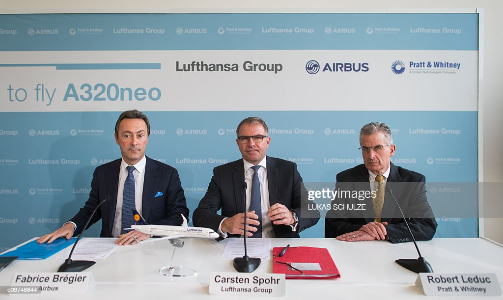 President and CEO of Airbus Fabrice Bregier, the chairman of the Lufthansa Group Carsten Spohr and the president of Pratt & Whitney Robert Leduc attend a press conference on February 12, 2016 in Hamburg, northern Germany. The first Airbus A320neo plane was delivererd to German airline Lufthansa. / AFP / dpa / Lukas Schulze / Germany OUT