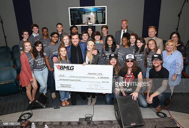 President and CEO of Big Machine Records Scott Borchetta presents a cheque to the Metro Nashville Public Schools Music Makes Us program at SiriusXM...