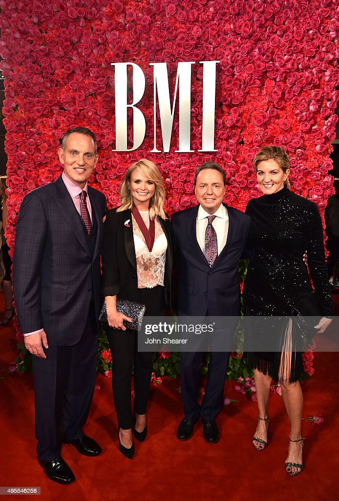 President and CEO of BMI Michael O'Neill and BMI Vice President Writer/Publisher Relations Nashville Jody Williams pose with musical artist Miranda...