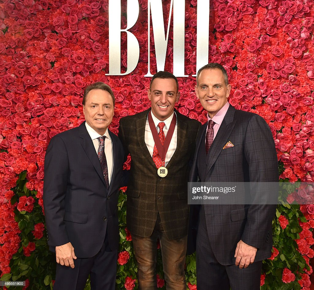 President and CEO of BMI Michael O'Neill and BMI Vice President Writer/Publisher Relations Nashville Jody Williams pose with recording artist Trent...