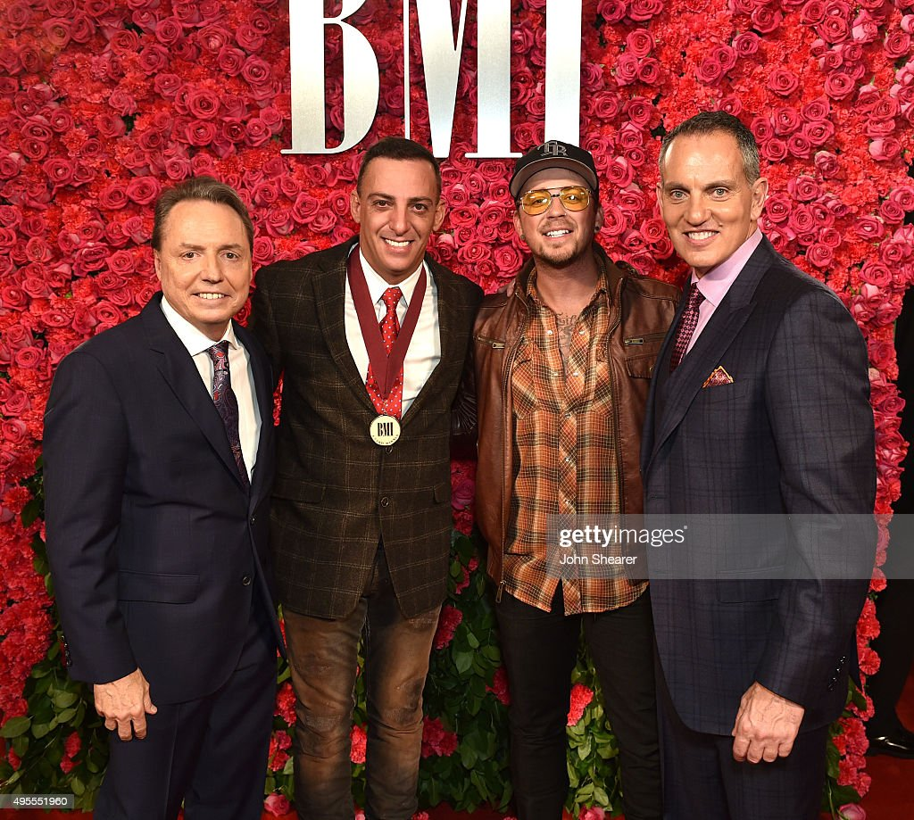 President and CEO of BMI Michael O'Neill and BMI Vice President Writer/Publisher Relations Nashville Jody Williams pose with singersongwriter Trent...