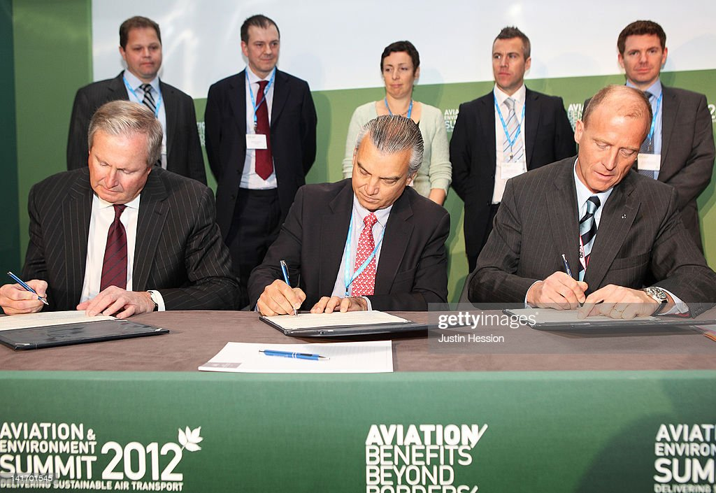 President and CEO of Boeing Jim Albaugh, President Commercial Aviation at Embraer SA, Paulo Cesar de Souza e Silva, and President and CEO of Airbus Tom Enders sign the industry intitiative on sustainable bio fuels during the Aviation and Environment Summit on March 22, 2012 in Geneva, Switzerland.