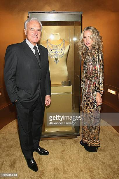 President and CEO of Cartier International Bernard Fornas and stylist Rachel Zoe pose by the Cartier Patiala necklace at a private dinner in honor of...
