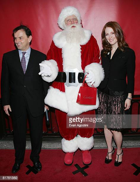 President and CEO of Cartier Stanislas de Quercize poses with Santa Claus and actress Julianne Moore attends the 25th anniversary of the Cartier...