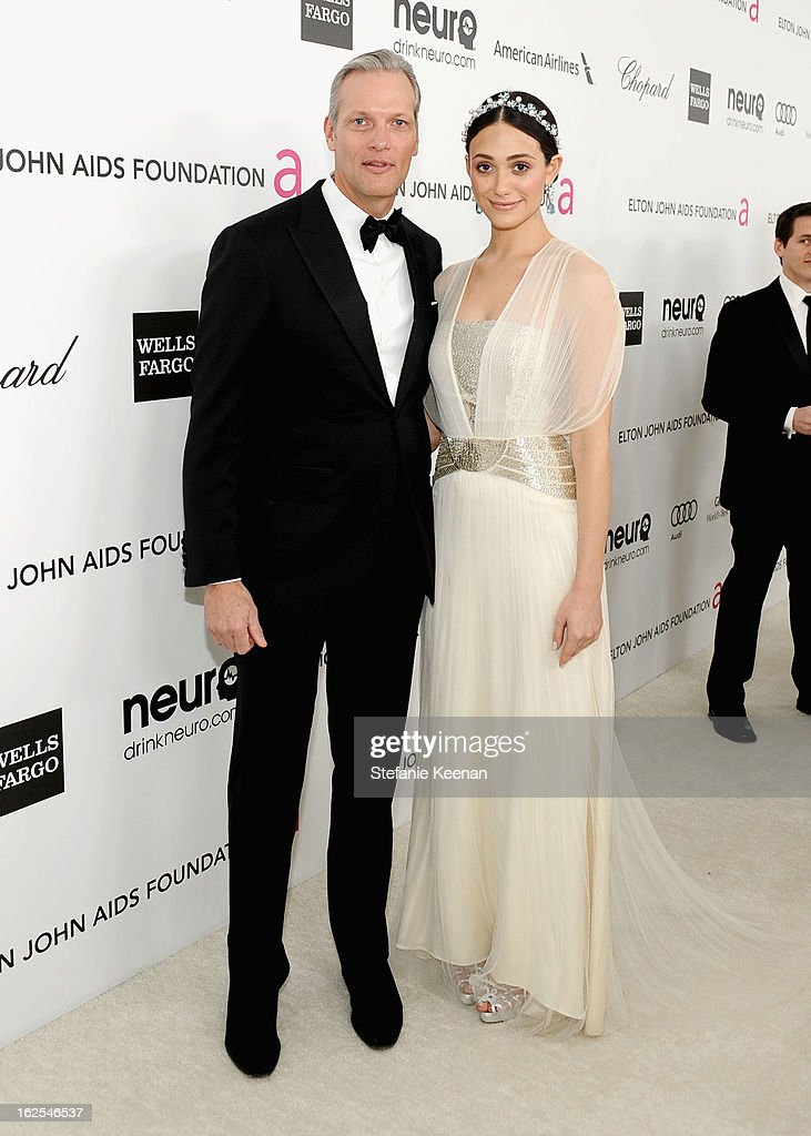 President and CEO of Chopard USA Marc Hruschka and actress Emmy Rossum attend Chopard at 21st Annual Elton John AIDS Foundation Academy Awards Viewing Party at West Hollywood Park on February 24, 2013 in West Hollywood, California.