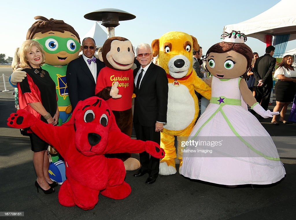 President and CEO of Corporation for Public Broadcasting, Patricia S. Harrison, Super Why, Clifford, CEO of Sesame Workshop H. Melvin Ming, Curious George, President and CEO of PBS SoCaL, Mel Rogers, Martha and Princess Presto attend the PBS SoCaL Presents the 2012 Masterpiece Ball on May 5, 2012 at the Atlantic Aviation Hanger in Santa Ana, California.