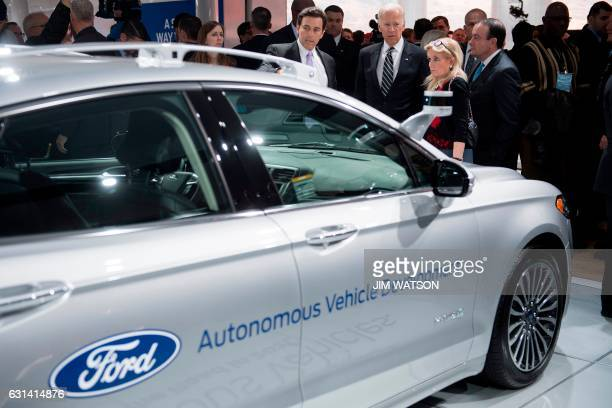 President and CEO of Ford Motor Company Mark Fields talks with US Vice President Joe Biden and US Congresswoman Debbie Dingell DMichigan next to the...