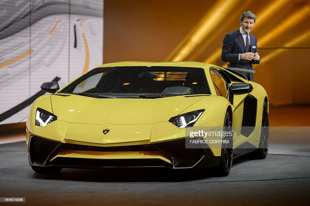 President and CEO of Lamborghini Stephan Winkelmann present the new Lamborghini Aventador SV model car during a preview of German carmaker Volkwagen...