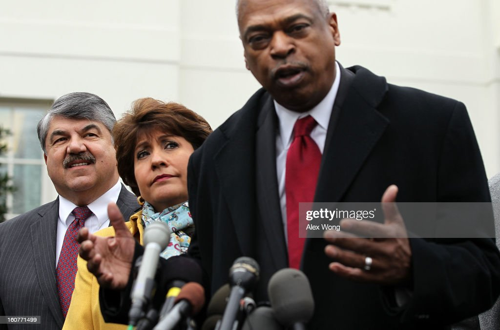 President and CEO of Leadership Conference on Civil and Human Rights Wade Henderson (R) speaks to the press after a meeting with U.S. President Barack Obama at the White House as AFL-CIO President <a gi-track='captionPersonalityLinkClicked' href=/galleries/search?phrase=Richard+Trumka&family=editorial&specificpeople=2701507 ng-click='$event.stopPropagation()'>Richard Trumka</a> (L), and President and CEO of National Council of la Raza <a gi-track='captionPersonalityLinkClicked' href=/galleries/search?phrase=Janet+Murguia&family=editorial&specificpeople=646135 ng-click='$event.stopPropagation()'>Janet Murguia</a> (2nd L) listen February 5, 2013 in Washington, DC. Obama was meeting with labor leaders to discuss issues including immigration reform, economy, and deficit reduction.