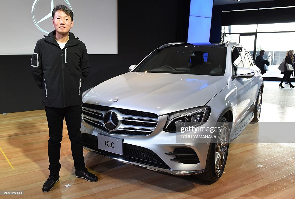President and CEO of Mercedes-Benz Japan Kintaro Ueno introduces the new sport utility vehicle Mercedes-Benz GLC at its showroom in Tokyo on February 9, 2016. The company released the new vehicle with a two-litre turbo engine from February 9 all over Japan. AFP PHOTO / Toru YAMANAKA / AFP / TORU YAMANAKA