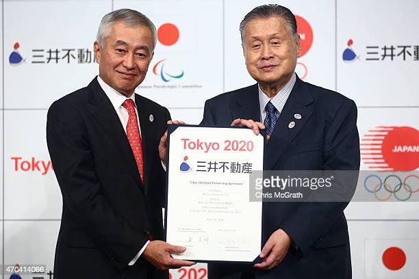 President and CEO of Mitsui Fudosan Masanobu Komoda and Tokyo 2020 Olympic organizing committee Chairman Yoshiro Mori pose for photographers during a...