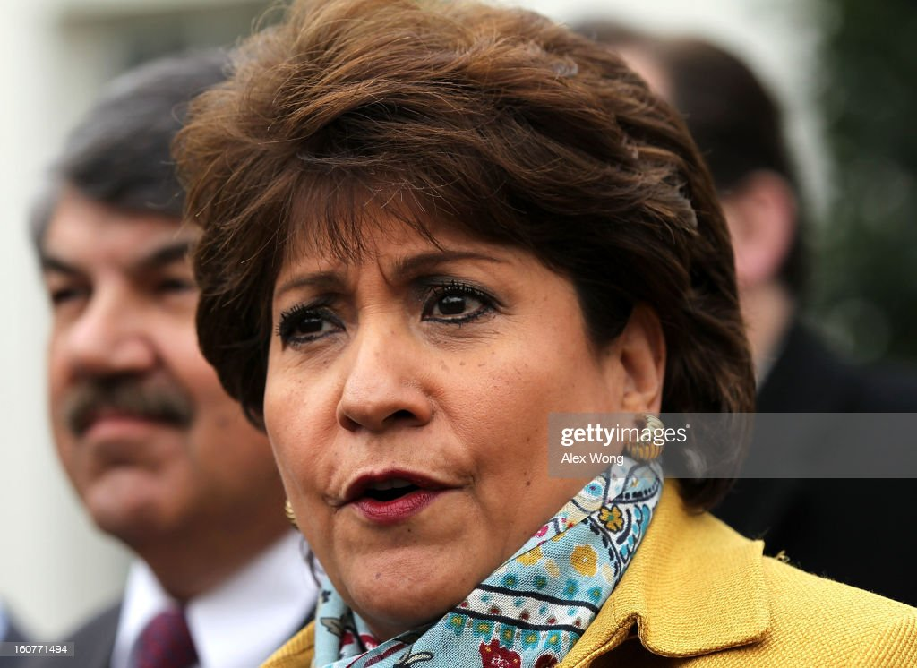 President and CEO of National Council of la Raza <a gi-track='captionPersonalityLinkClicked' href=/galleries/search?phrase=Janet+Murguia&family=editorial&specificpeople=646135 ng-click='$event.stopPropagation()'>Janet Murguia</a> (R) speaks to the press after a meeting with U.S. President Barack Obama at the White House as AFL-CIO President <a gi-track='captionPersonalityLinkClicked' href=/galleries/search?phrase=Richard+Trumka&family=editorial&specificpeople=2701507 ng-click='$event.stopPropagation()'>Richard Trumka</a> (L) listens February 5, 2013 in Washington, DC. Obama was meeting with labor leaders to discuss issues including immigration reform, economy, and deficit reduction.