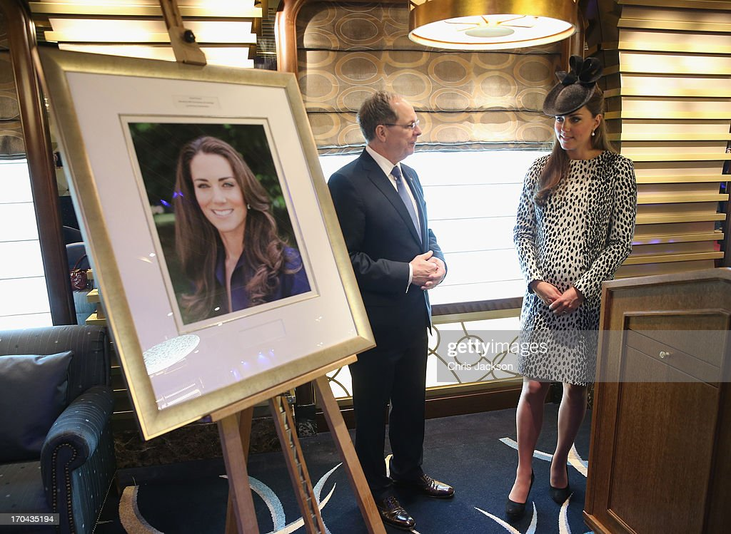President and CEO of Princess Cruises Alan Buckelew escorts <a gi-track='captionPersonalityLinkClicked' href=/galleries/search?phrase=Catherine+-+Duchess+of+Cambridge&family=editorial&specificpeople=542588 ng-click='$event.stopPropagation()'>Catherine</a>, Duchess of Cambridge as she looks at an image taken of herself by Getty photographer Chris Jackson during a tour of the Princess Cruises ship after its naming ceremony at Ocean Terminal on June 13, 2013 in Southampton, England.