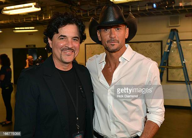 President and CEO of the Big Machine Label Group Scott Borchetta and Tim McGraw backstage during Keith Urban's Fourth annual We're All For The Hall...