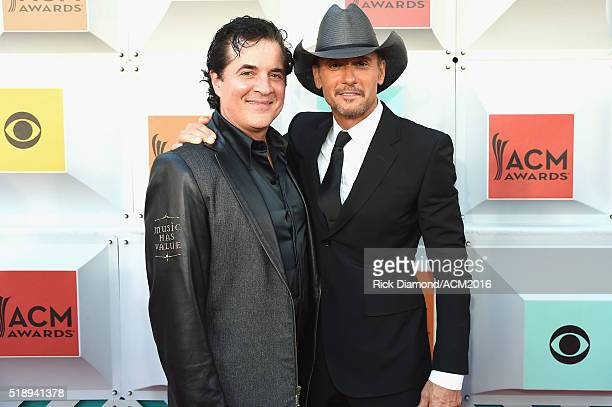 President and CEO of the Big Machine Label Group Scott Borchetta and recording artist Tim McGraw attend the 51st Academy of Country Music Awards at...