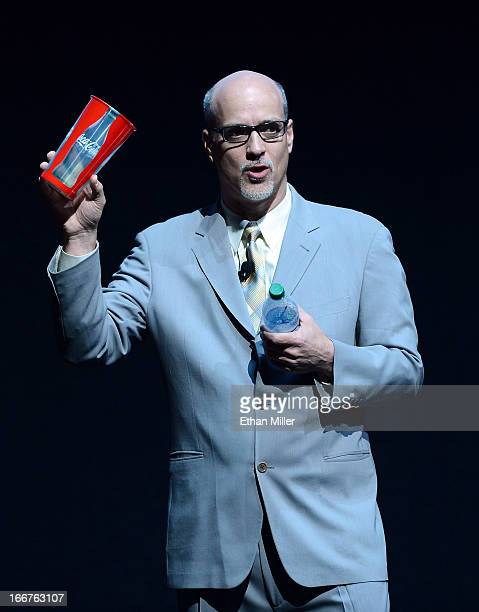 President and CEO of the National Association of Theatre Owners John Fithian holds up a 44ounce CocaCola cup and a bottle of Dasani water in...