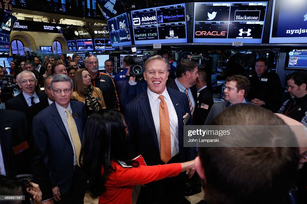 President and CEO of the Super Bowl Host Committee Al Kelly and Executiive VP of Football operatiohns, Denver Broncos, <a gi-track='captionPersonalityLinkClicked' href=/galleries/search?phrase=John+Elway&family=editorial&specificpeople=204173 ng-click='$event.stopPropagation()'>John Elway</a> ring the opening bell at New York Stock Exchange on January 30, 2014 in New York City.