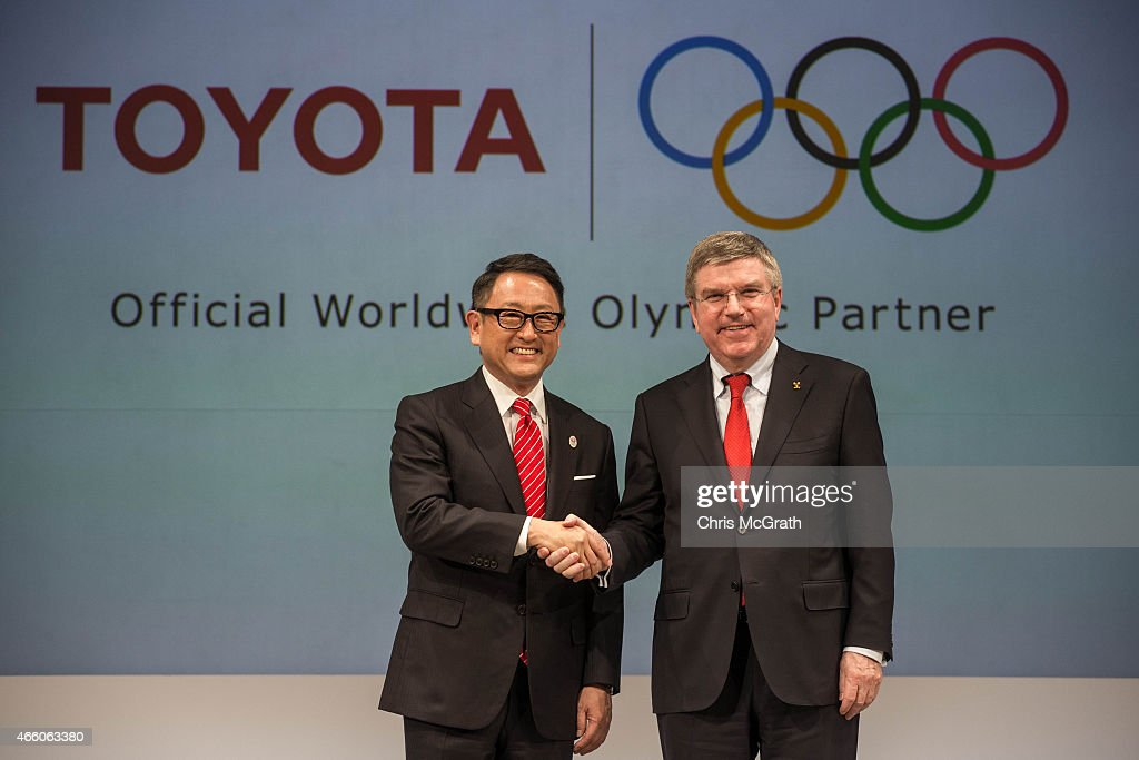President and CEO of Toyota Motor Corporation, <a gi-track='captionPersonalityLinkClicked' href=/galleries/search?phrase=Akio+Toyoda&family=editorial&specificpeople=2334399 ng-click='$event.stopPropagation()'>Akio Toyoda</a> and President of the International Olympic Committee <a gi-track='captionPersonalityLinkClicked' href=/galleries/search?phrase=Thomas+Bach&family=editorial&specificpeople=610149 ng-click='$event.stopPropagation()'>Thomas Bach</a> pose for photographers during a news conference at the Imperial Hotel on March 13, 2015 in Tokyo, Japan. Toyota Motor Co. signed with IOC to join The Olympic Partner Programme (TOP).